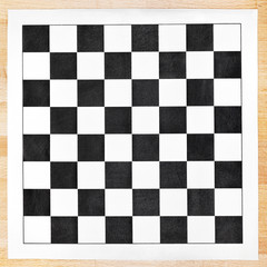 black and white vinyl checkerboard on wooden table