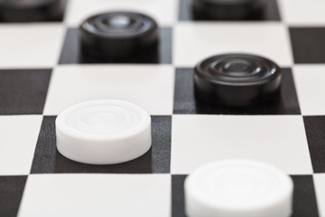 draughts on black and white vinyl board