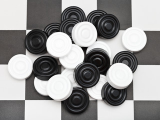 pile of draughts on checkerboard