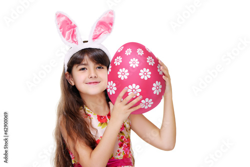 girl in bunny ears holding pink easter egg