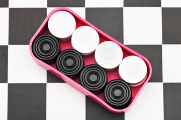 box with checkers on checkerboard