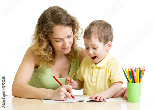 child boy and mother draw with colorful pencils
