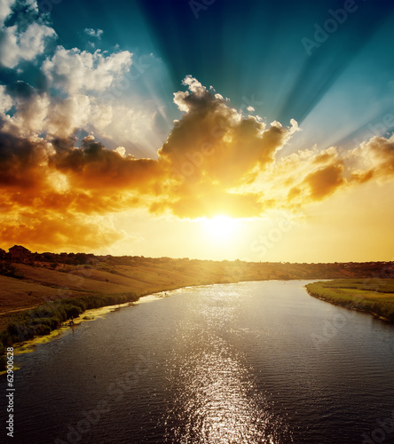 cloudy sunset over river