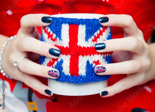 Women's hands keeping the cup with British symbol