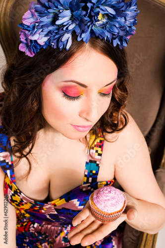 beautiful smiling young woman with a cake
