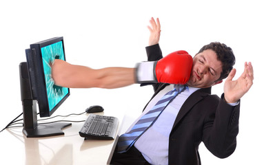 Business man with computer hit by boxing glove in stress concept
