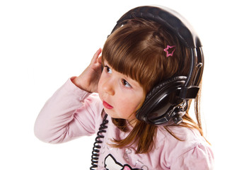 Beautiful cute happy little girl with headphones