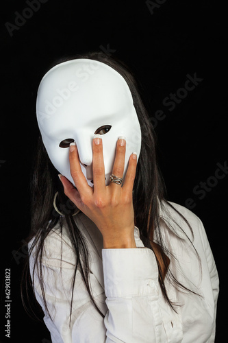 beautiful woman staring at a white mask