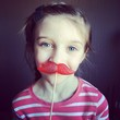 girl with candy moustache