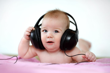 baby listening to music through headphones