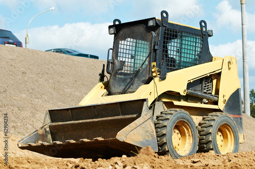 skid steer loader at earth moving works