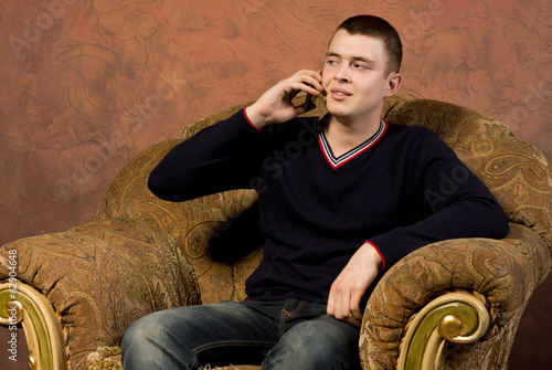Sceptical young man talking on his mobile