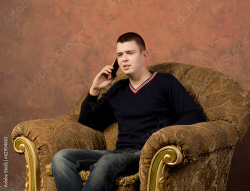 Concerned young man talking on his mobile