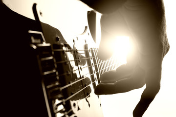 Guitarist plays on stage. Closeup view
