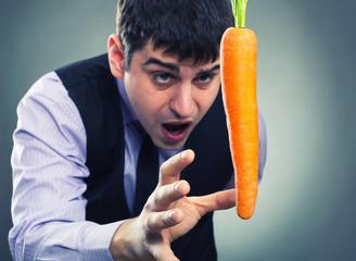 Bait metaphor. Man and carrot .
