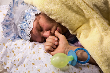 Man weared as baby sleep sucking his thumb