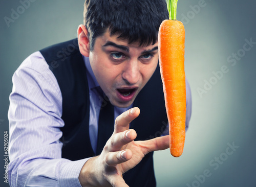 Bait metaphor. Man and carrot .