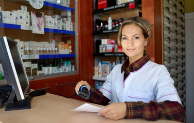 young female pharmacist holding prescription