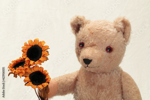 Vintage Teddy Bear Brings Flowers