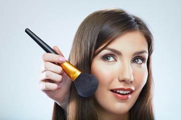 Woman face. Make up brush.