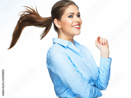 Business woman positive emotion portrait. Long motion hair. Iso