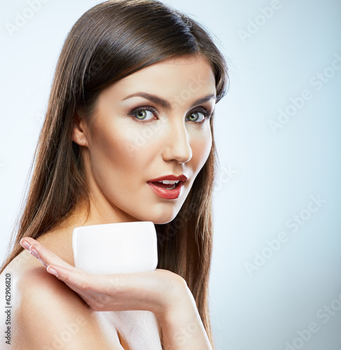 Woman with cream, lotion. Body care style portrait of young mod