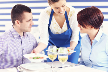 Couple being served in a restaurant