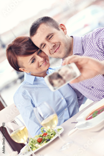 Young couple taking a picture in a restaurant