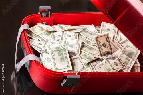 Suitcase with dollars.