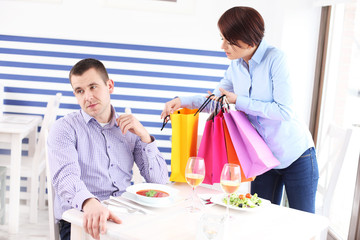 Woman showing her new purchase to husband
