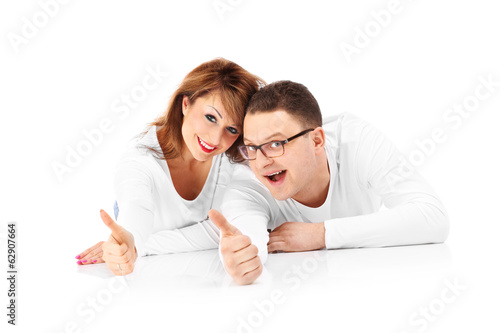 Couple showing ok signs