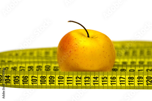 fresh red-yellow apple with measuring tape. isolated over white