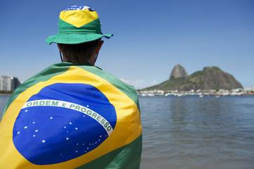 Patriotic Brazil Fan Standing Wrapped in Brazilian Flag Rio
