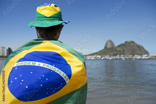 Patriotic Brazil Fan Standing Wrapped in Brazilian Flag Rio