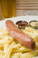 authentic kielbasa Polish sausage with french fries as photogpra