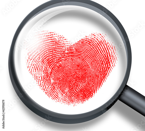 red fingerprint in heart shape through magnifying glass