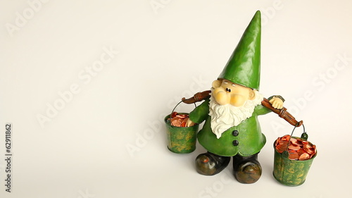 Gnome carrying money buckets isolated on gray white