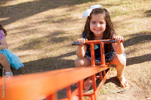 Little girl in a seesaw