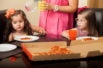 Little friends having pizza at home
