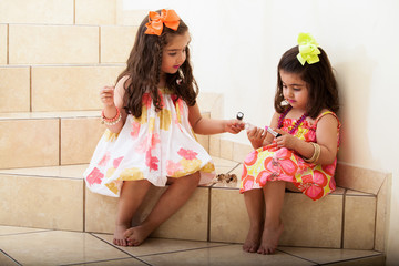 Little girls trying some makeup on