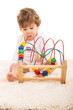 Boy playing with wooden toy