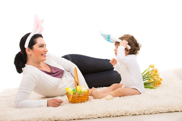 Happy mother and boy with Easter basket