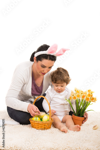 Mother and son arrange Easter basket