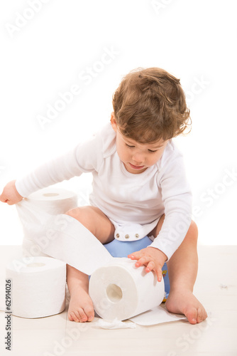 Toddler boy tear toilet paper