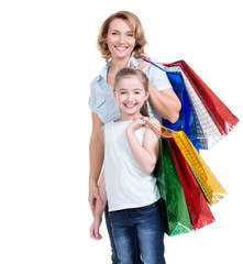mother and young daughter with shopping bags