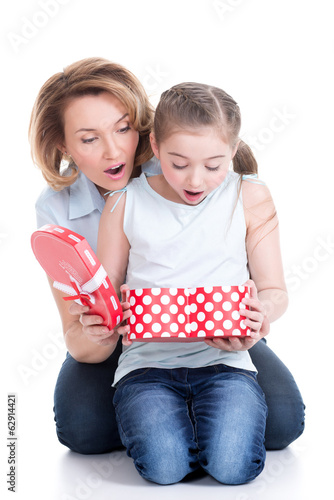 mother and young daughter looking into the box with gift