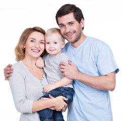 Portrait of the happy family with little child.