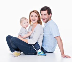 Happy young family with little child.