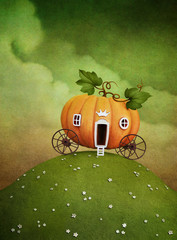 Pumpkin carriage on green hill