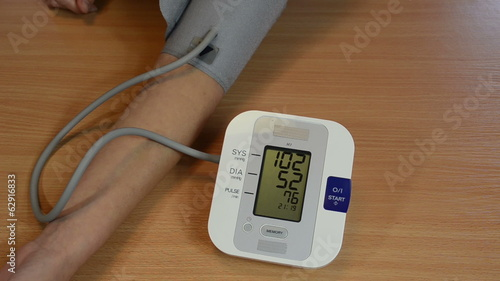 female patient measuring her blood pressure numbers vary